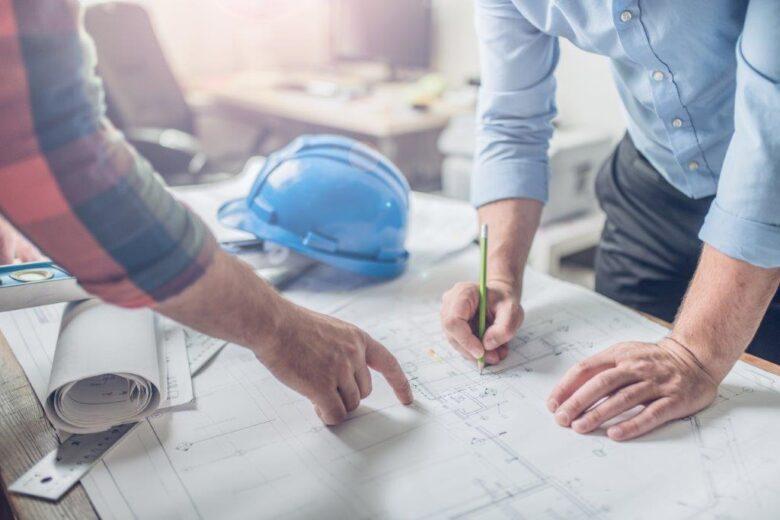 Two Men Reviewing a Blueprint